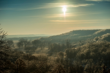 The morning sun shines on the sparkling ice covered Osage Hills.